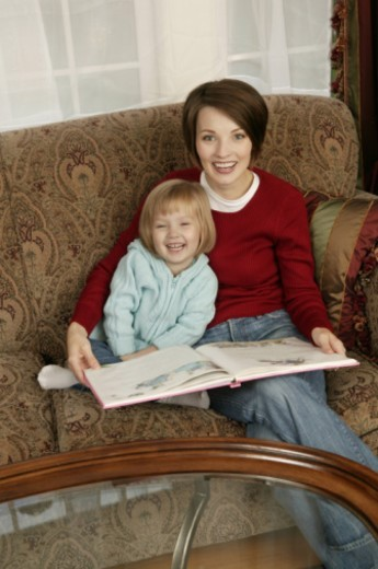 Mother and daughter reading : Stock Photo