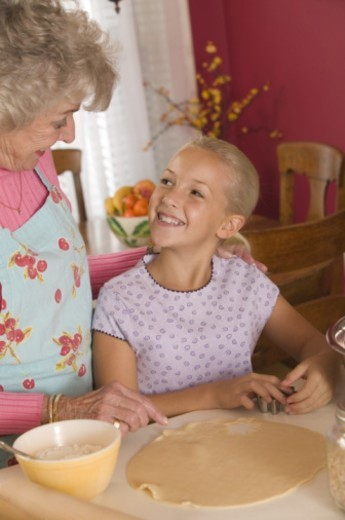 Grandmother and granddaughter baking : Stock Photo