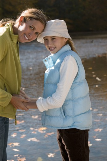 Mother and daughter outdoor : Stock Photo