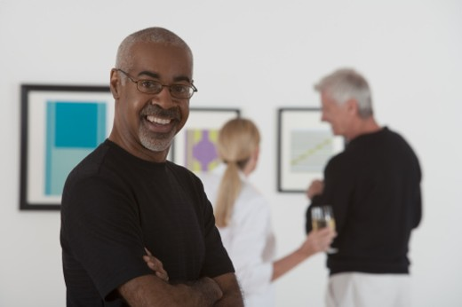 Smiling man in art gallery : Stock Photo