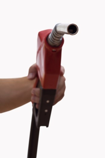 Hand holding a gas pump : Stock Photo