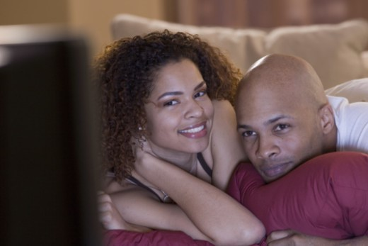 Couple watching television : Stock Photo