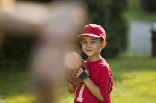 Stock Photo: 1557R-298761 Boy holding a baseball glove