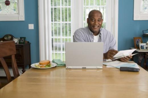 Stock Photo: 1557R-299065 Busy man multitasking