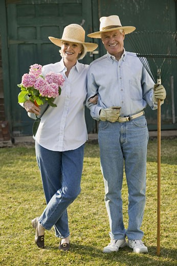 Couple with gardening supplies : Stock Photo