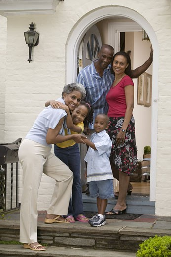 Family with grandmother on front porch : Stock Photo