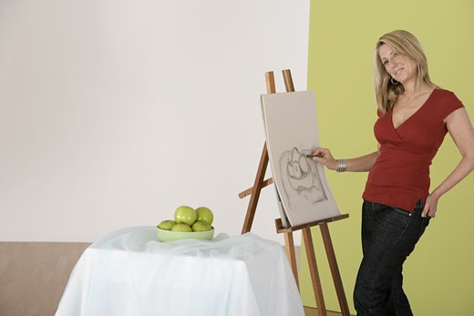 Stock Photo: 1557R-299485 Woman artist drawing
