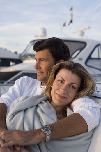 Woman snuggling with man on yacht : Stock Photo