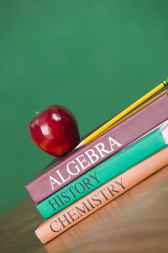 Stock Photo: 1557R-299868 Textbooks and an apple