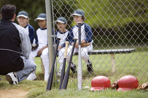 Coach with youth league team and baseball equipment : Stock Photo