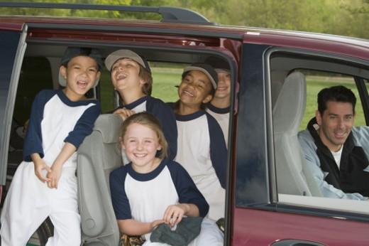 Youth league team in minivan : Stock Photo