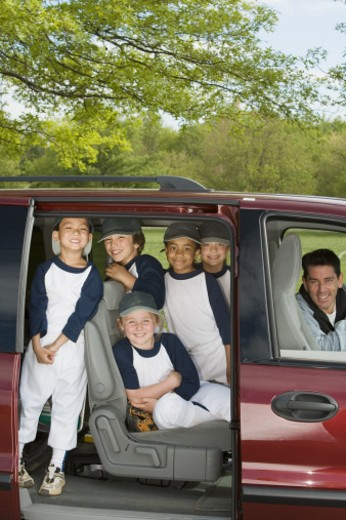 Youth league team in minivan : Stock Photo