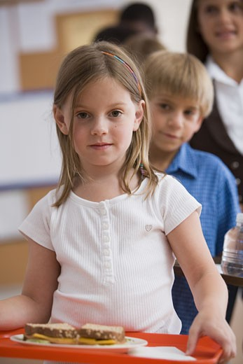 Children standing in lunch line : Stock Photo