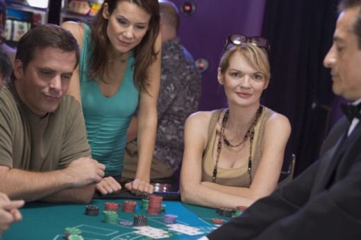 Stock Photo: 1557R-301210 Man and women playing blackjack in casino