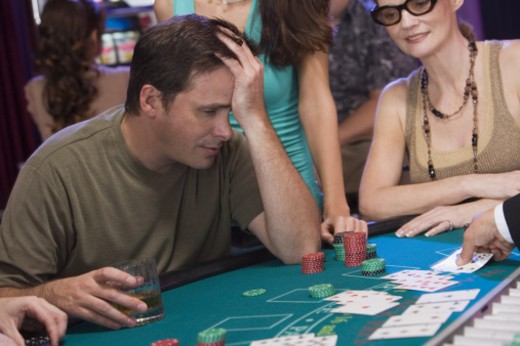 Man at blackjack table with only one chip : Stock Photo