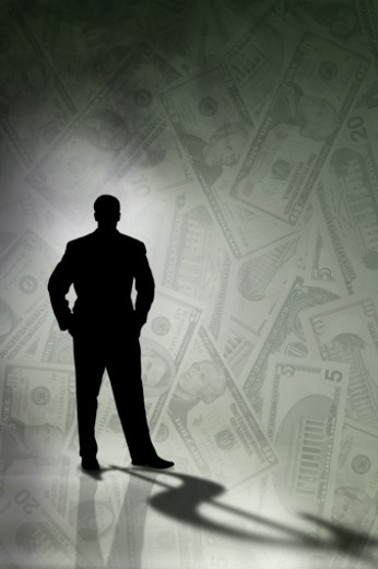 Stock Photo: 1557R-301306 Silhouette of man with money
