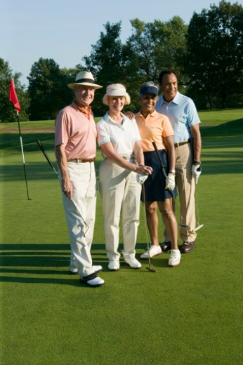 Couples playing golf : Stock Photo
