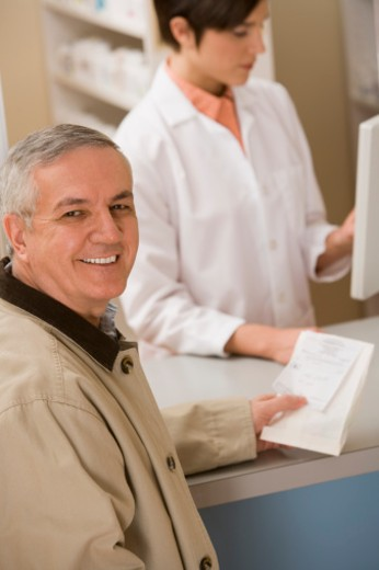 Stock Photo: 1557R-301684 Man holding a prescription