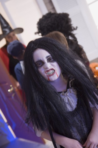 Stock Photo: 1557R-301797 Girl in vampire costume growling