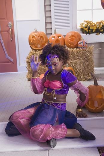 Girl posing in Halloween costume : Stock Photo