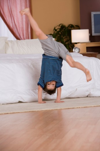 Stock Photo: 1557R-302493 Boy doing cartwheel