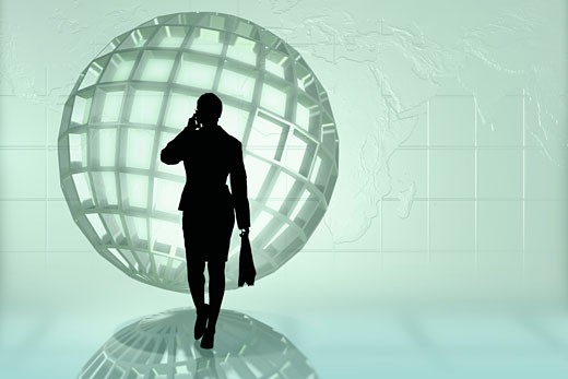 Businesswoman on cell phone near sphere : Stock Photo