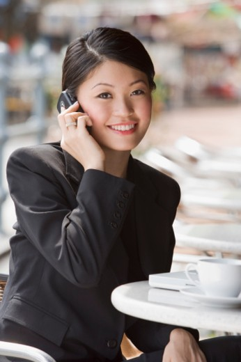 Stock Photo: 1557R-304156 Smiling businesswoman on cellular phone