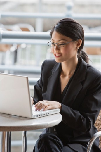 Stock Photo: 1557R-304159 Businesswoman using laptop computer