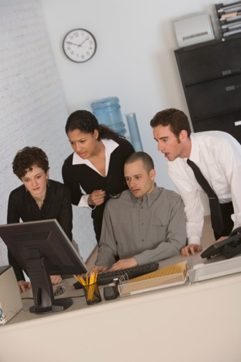 Shocked businesspeople looking at computer : Stock Photo