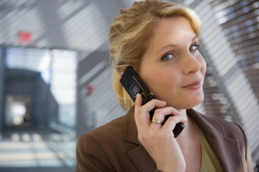 Smiling businesswoman on cellular phone : Stock Photo