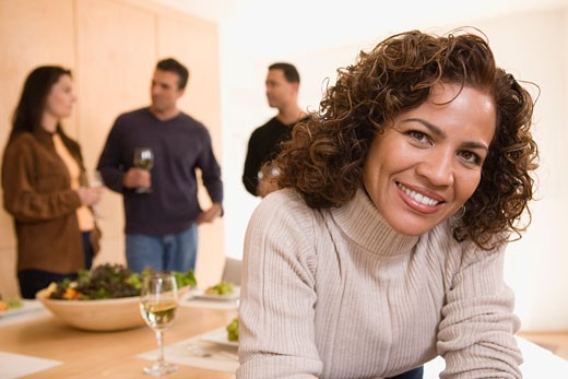 Stock Photo: 1557R-304684 Smiling woman at dinner party