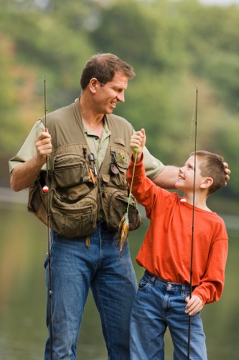 Stock Photo: 1557R-304747 Father and son fishing.
