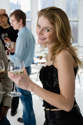 Stock Photo: 1557R-304820 Smiling woman with glass of wine