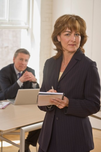 Confident businesswoman with notepad : Stock Photo