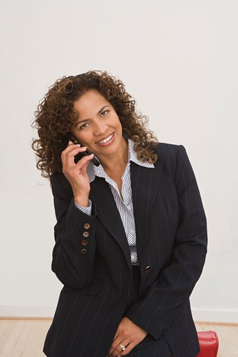 Smiling businesswoman on cell phone : Stock Photo