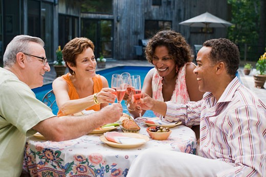 Friends toasting wine at outdoor dinner party : Stock Photo