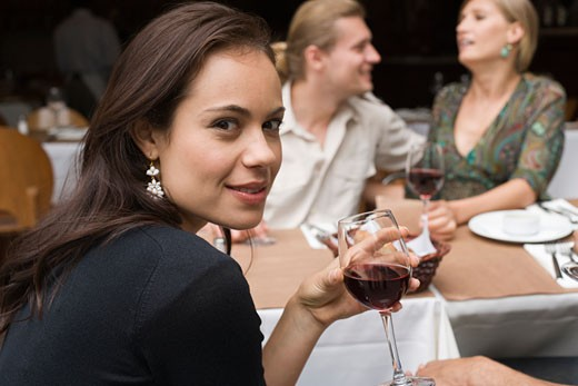 Woman with glass of wine at outdoor cafe : Stock Photo