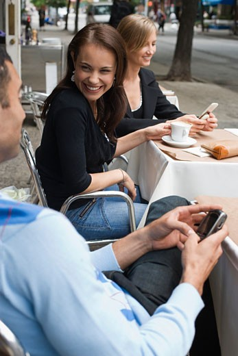 Smiling woman talking to man at outdoor cafe : Stock Photo