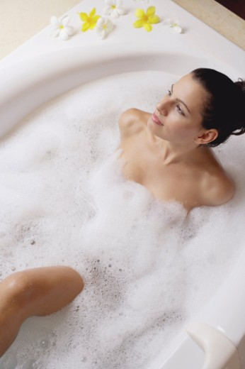Stock Photo: 1557R-307456 Woman relaxing in bubble bath