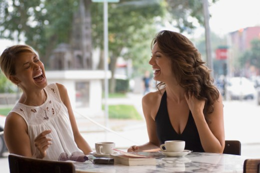 Laughing women in cafe : Stock Photo