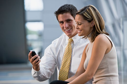 Couple with cell phone : Stock Photo