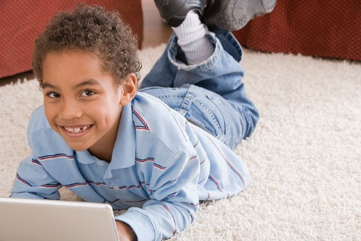 Stock Photo: 1557R-310023 Portrait of boy using laptop