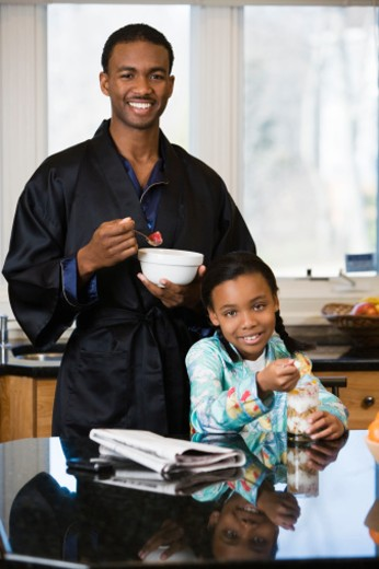 Father and daughter eating breakfast : Stock Photo