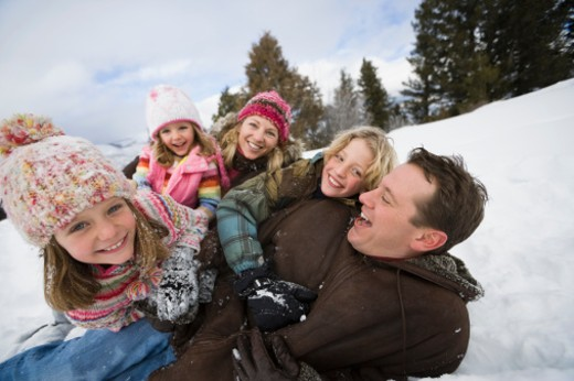 Family in snow : Stock Photo