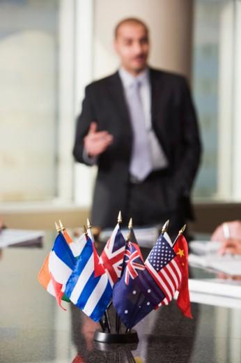 Businessman giving an international presentation : Stock Photo