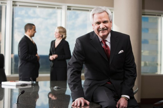 Businessman in corporate office : Stock Photo