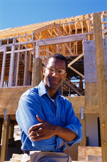 Contractor at construction site : Stock Photo