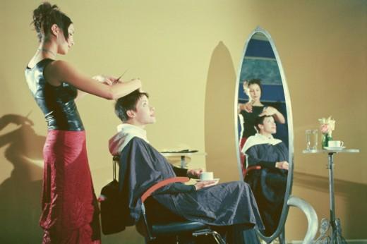 Woman getting hair cut : Stock Photo