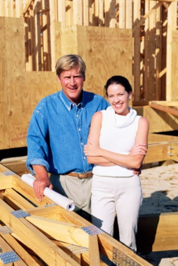 Couple posing at construction site : Stock Photo