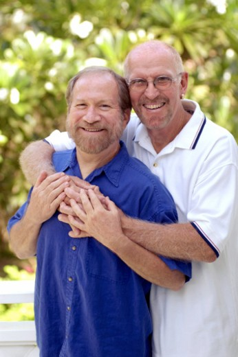 Stock Photo: 1557R-312173 Portrait of male couple hugging